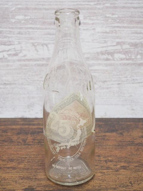 コカ・コーラ生誕100年記念ボトルの空瓶(王冠なし)の後側